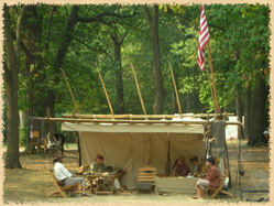 reenactors in a lean-to tent